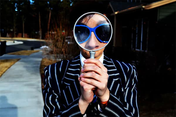 guy behind magnifying glass